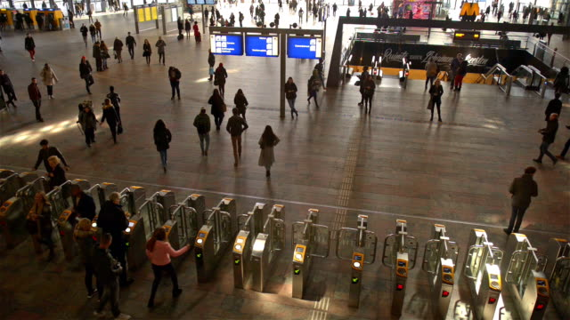 Commuters in train station video