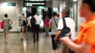 Commuters on escalators, at Singapore metro station. video