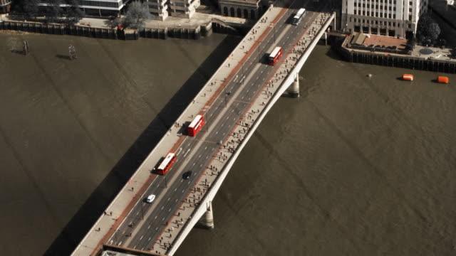 Commuters on London Bridge aerial shot video