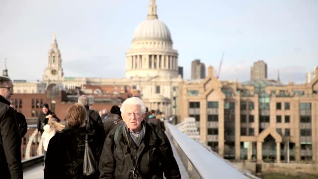 commuters on Millenium Bridge video