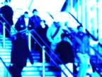 Commuters on station stairway. NTSC, PAL video