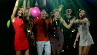 company of young and gay people dancing in a nightclub under incendiary music video
