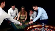 Company playing in casino. Black video