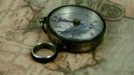 A compass and a ring on top of the map video