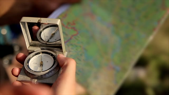 Compass and map in the hands,close up video