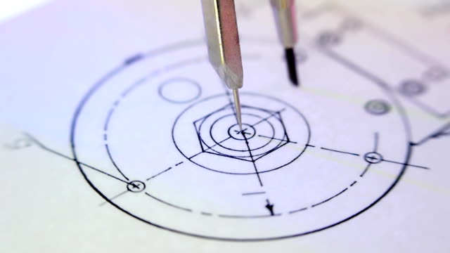 Compass draws circle on the drawing video