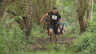 Competitors running through a forest at an endurance event video