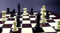 Complex position at chess game, while black queen is moving to squares on the board ending the game by checkmating the white king video