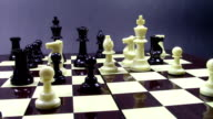 Complex position in the middle game of chess , while white pawn is taking initiative and advances two squares in front video