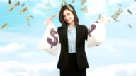 Composite video of businesswoman holding money bags video