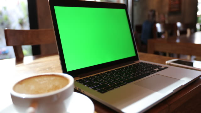 Computer laptop at coffee cafe,Green screen background video