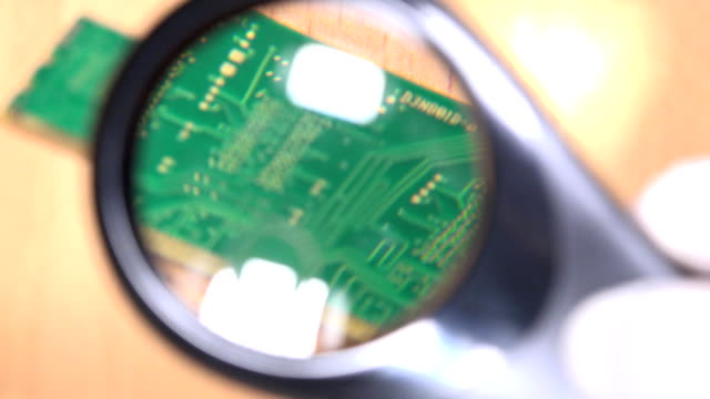 computer memory module details with magnifying glass. pc diagnostics video