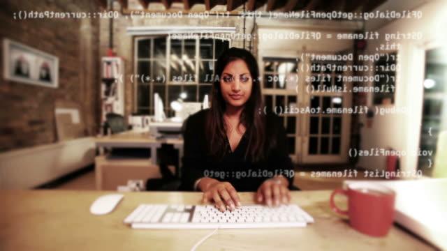 Computer programmer writes data video