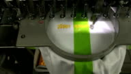 Computerized embroidery machine, working on lacing Thai student name on T-shirt video