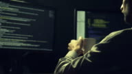 Concentrated hacker cracking a database video