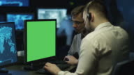 Concentrated Programmers Work on Personal Computers Located in a System Control Room. Computer has Green Screen. video