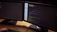 Concentrated software developer writing programming code video