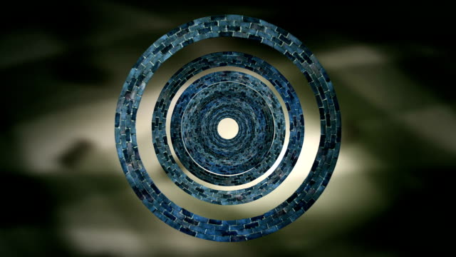 Concentric Spinning Circles Against Shimmering Background video