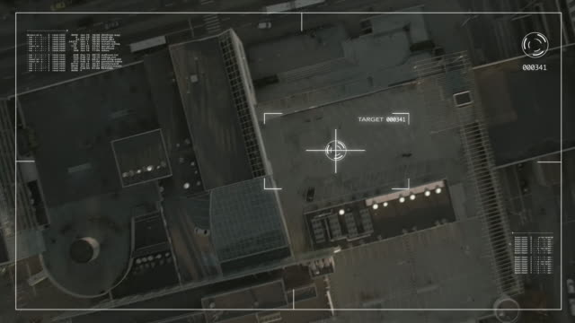 Concept footage of businessman under satellite surveillance starring at us while holding a mobile phone on the parking lot. video