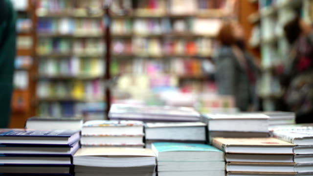 Concept learning and knowledge. Bookstore shelves with book stacks in bookstore video