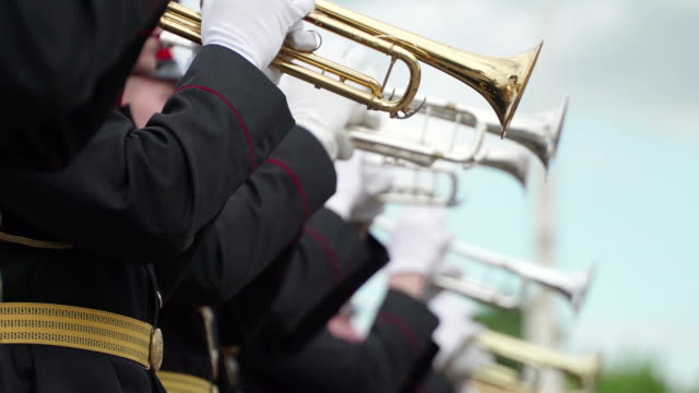 Concept peace military. Military brass band take concert for civilians in the city Park. Artists in white gloves video