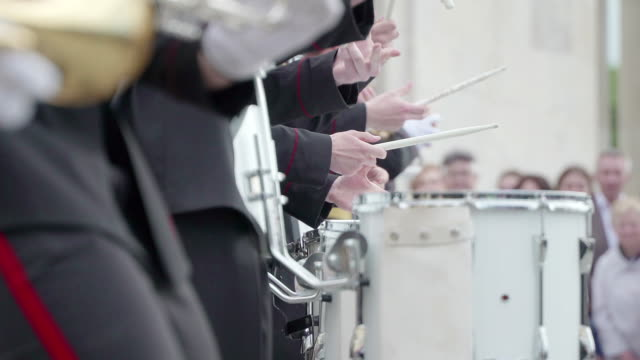 Concept peace military. Military brass band take concert for civilians in the city Park. Drums and drumsticks. Artists in white gloves video