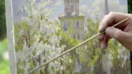 Concept Picture and Brush. Skilled Artist Draws Paints of Blossoming Apple Tree video