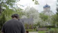 Concept Religion. Skilled Artist Draws Temple in Flowering Garden video