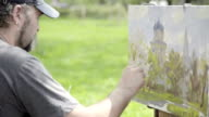 Concept Snow-white Spring. Skilled Artist Draws Paints of Blossoming Apple Tree video