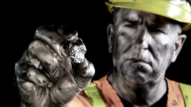 Conceptual video of a silver miner examining his precious metal discovery. video