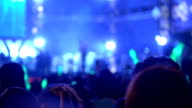MS Concert crowd dance at the night concert. Defocused shot video