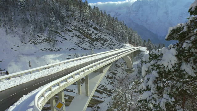 AERIAL: Concrete bridge on mountain pass in winter video