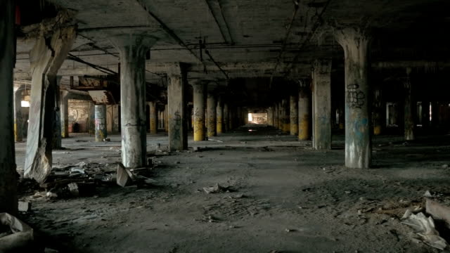CLOSE UP: Concrete pillars in rows in abandoned decaying underground parking lot video