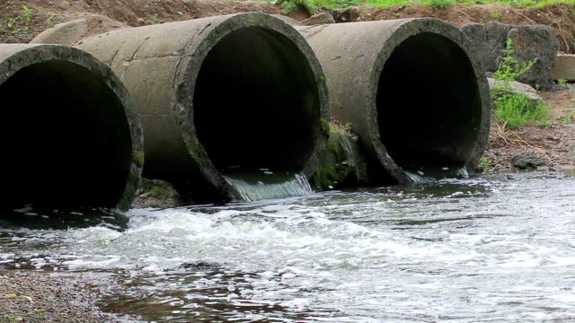 Concrete pipe from which the wastewater flows. video