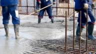 Concrete pouring at construction site video
