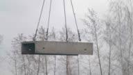 Concrete slabs hang on slings video