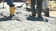 Concrete Workers Pouring and Troweling a New Driveway video