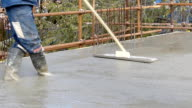 Concreting and smoothing slab on the building video