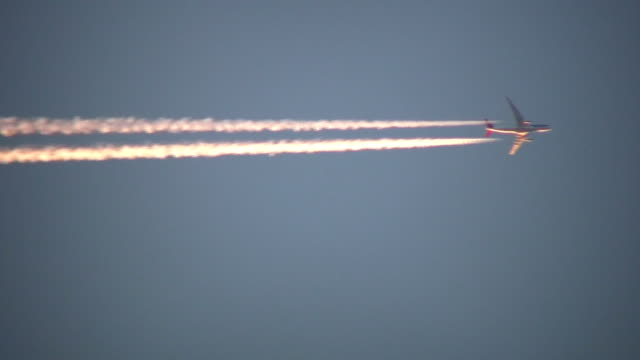 Condensation trails left behind from a passing airplane (High Definition) video