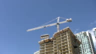 Condo construction crane. Light Time lapse. video
