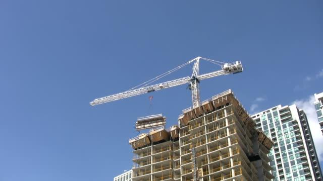 Condo construction crane. Light Time lapse. video