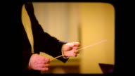 Conducting an orchestra. Retro video