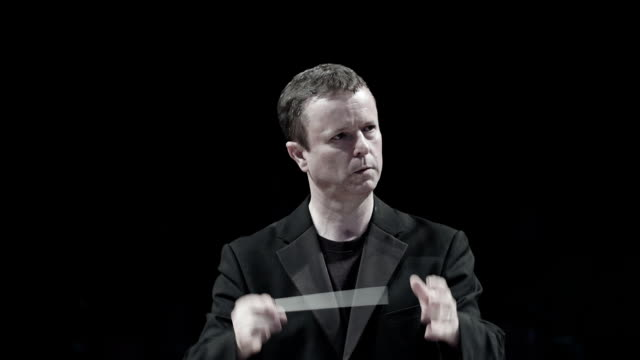 Conductor at work during a concert video