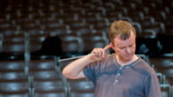 Conductor rehearses orchestra video
