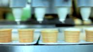 Cones filling with ice cream video