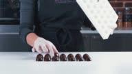 Confectioner chocolatiers checks ready chocolates video