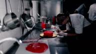 Confectioner decorates chocolate sphere. video