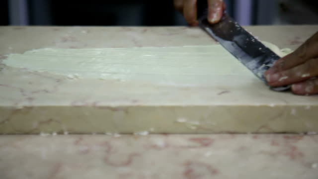 Confectioner Makes shapes from white chocolate video