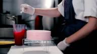 Confectioner mix glaze thickened cream. video