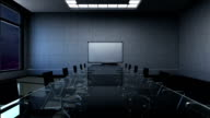 Conference room, forward moving, front white board presentation. night time. video